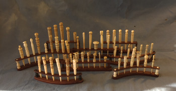 Stands for antique bodkin collection, made from rosewood, ebony & bone .