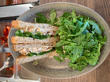Pulled chicken sandwich with mixed arugula