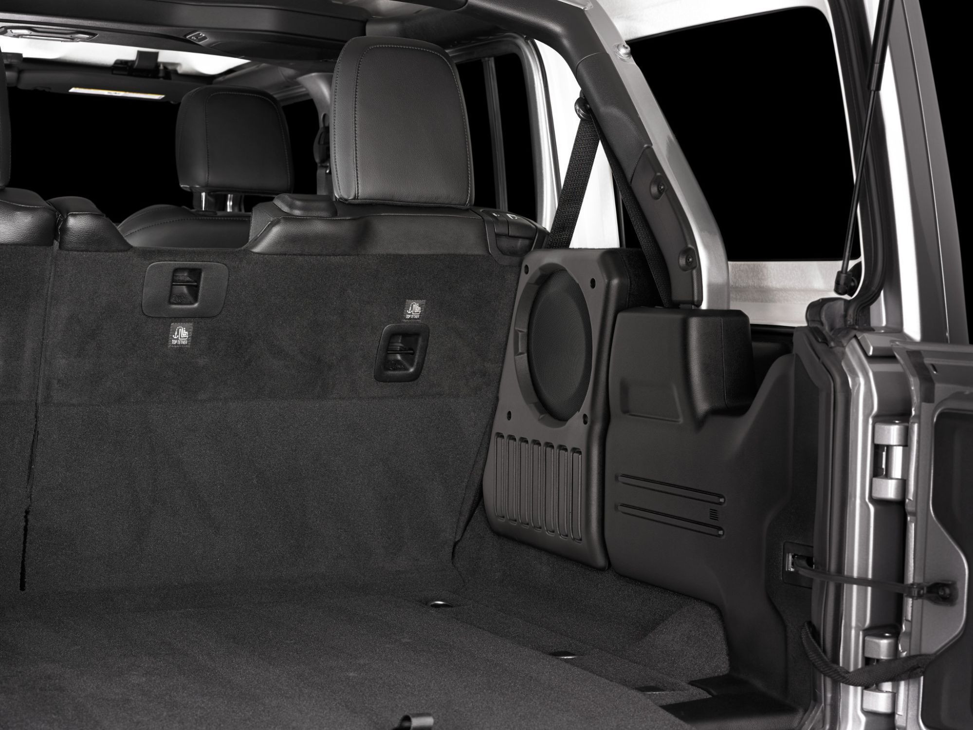 Image of the Jeep stealth box and sub installed showing how it does not impact the cargo area but boy it sure does put out the sound.