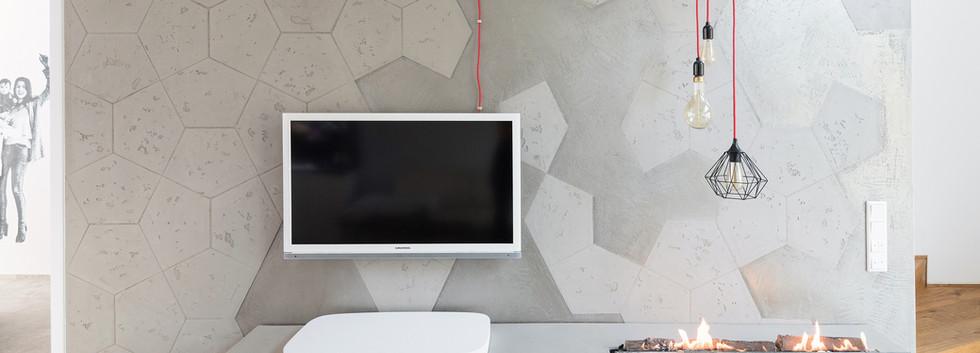 Frament Betonoptik an Fernseh Wand