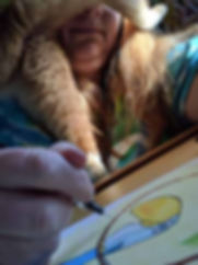 Robyn the cat testing illustrator Erin Kant Barnard's focus!