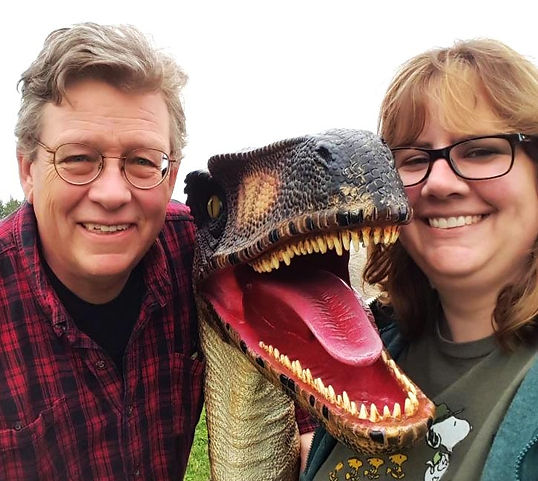 Author Kent Barnard and illustrator Erin Kant Barnard with a raptor!