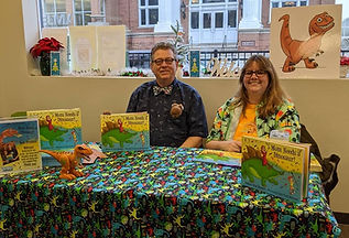 Author Kent Barnard and illustrator Erin Kant Barnard at a Mom Needs a Dinosaur! book signing
