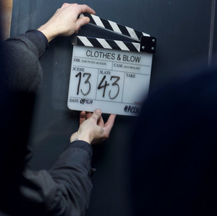 Preparing for a take on the set of 'Clothes & Blow'.