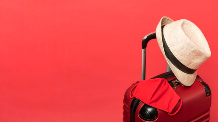 assortment-with-luggage-red-background_2