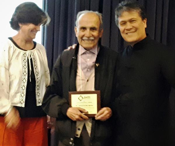 samuel e receiving award.jpg