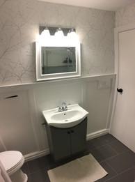 Custom washroom with custom trimwork.
