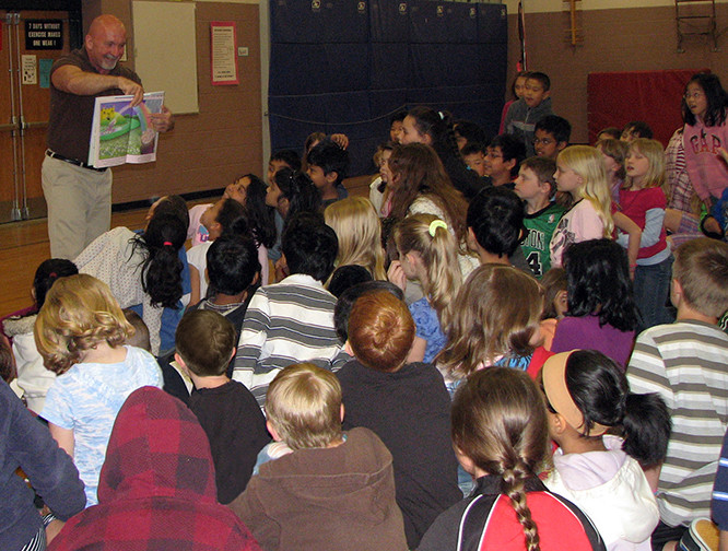 Author Peter Thomas doing a school presentation and reading to the students from his book, The Colors of Love