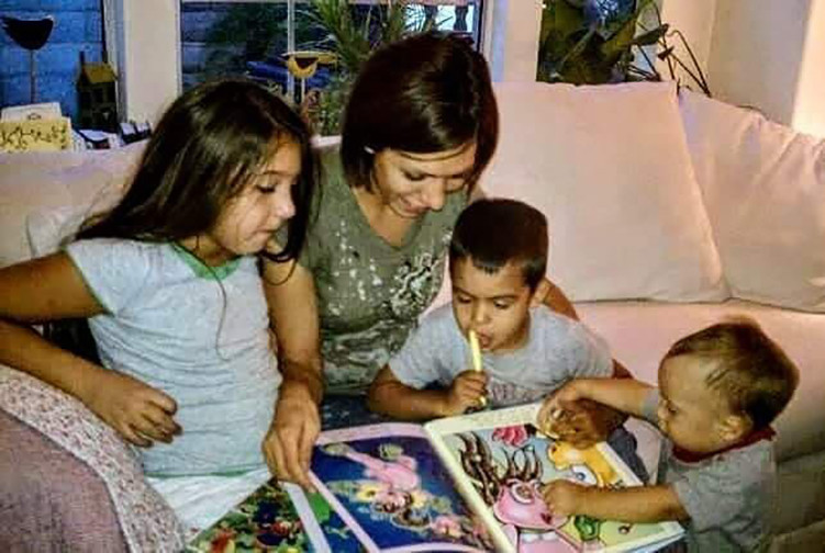A family being read story time adventures from the children's book series  The Adventures of Billy Bee
