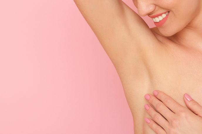 Close up of female armpit isolated on pi