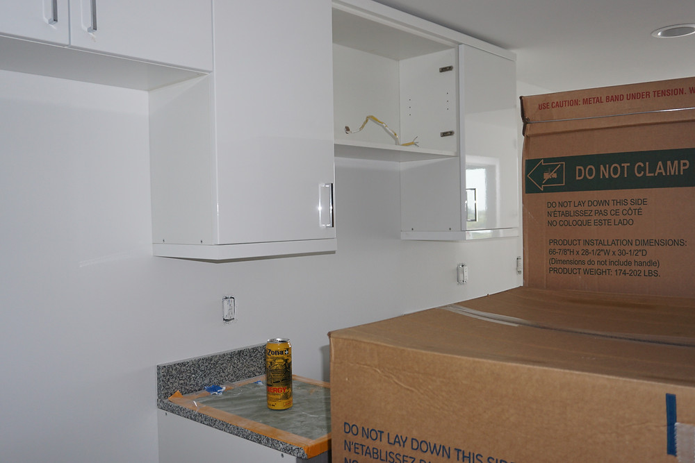 HDI Cabinetry Euro Series. Tuscan Smore and Cristallo White.  It is hard to show progress at this point as alot of it is internal.  Water is hooked up, Electric is hooked up, A/C units are on the roof.  Landscaping is starting in the next week or so.  Appliances are arriving as you can see!