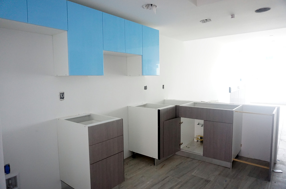 The blue is plastic covering the cabinets