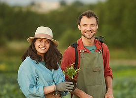 portrait-of-two-workers-in-field-at-vege