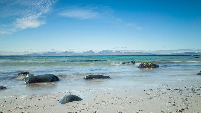 blue-sky-ocean-rocks-waters-sand.jpg