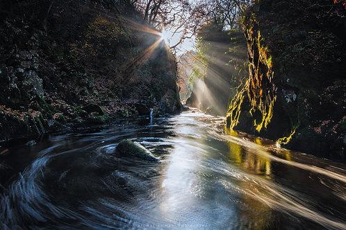 Sun rays bursting into Fairy Glen