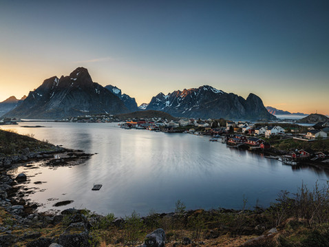 The sun setting on the Village of Reine