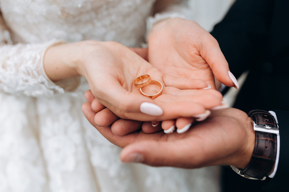 groom-holds-bride-s-hands-where-are-two-wedding-rings (3).jpg