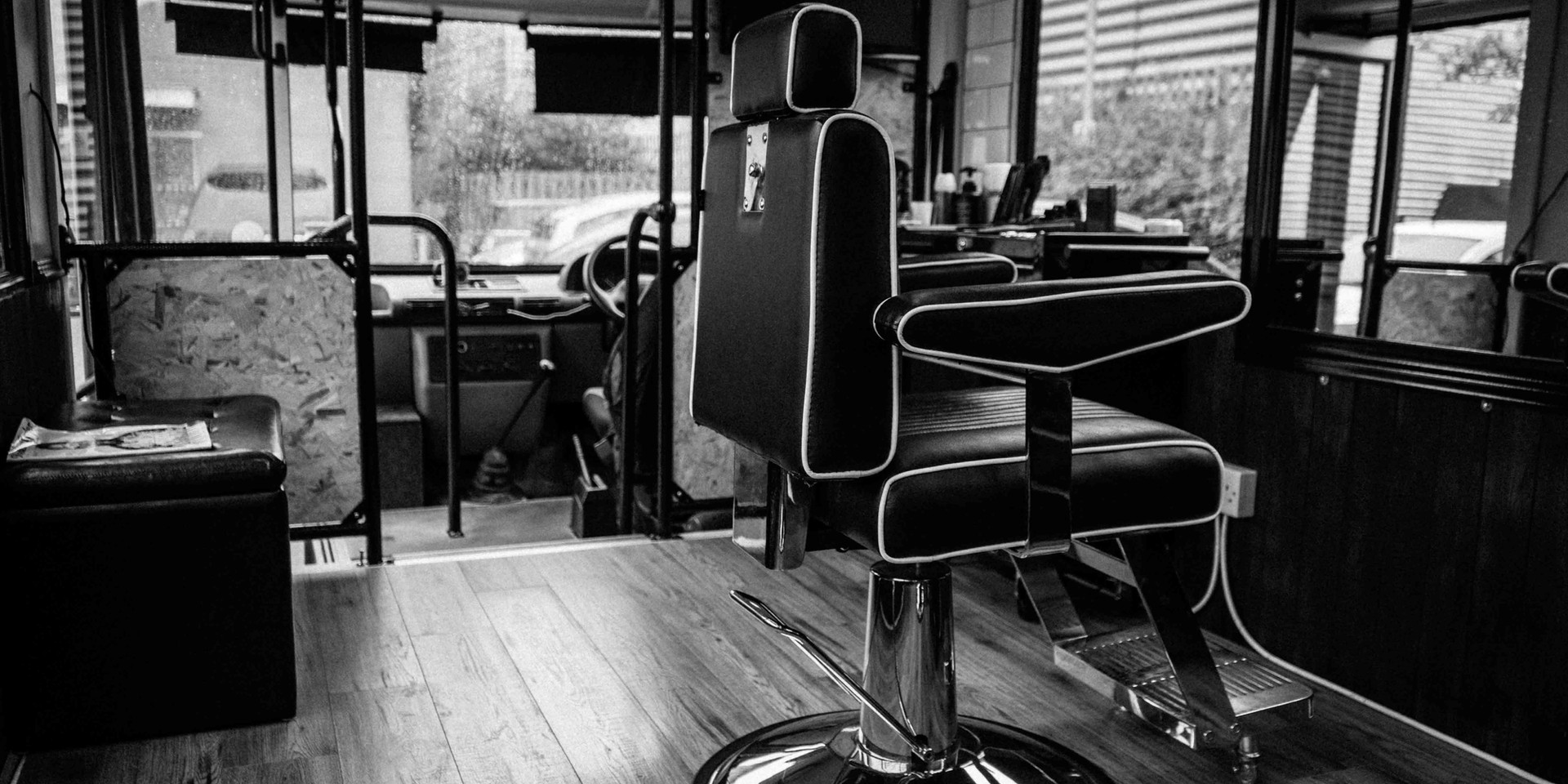 Brass Knuckle Barber co chair seating inside