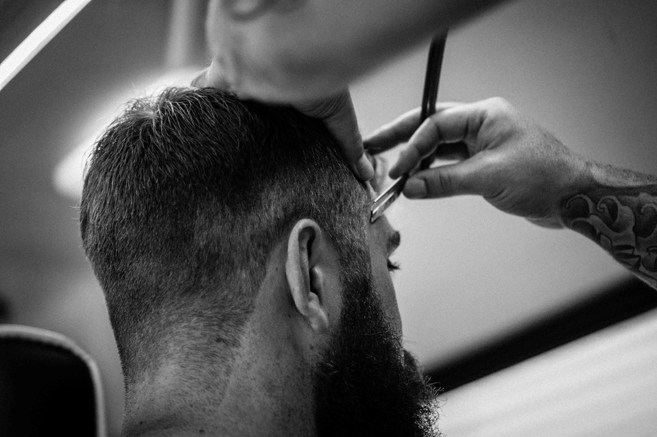 Brass Knuckle Barber co haircut and trim