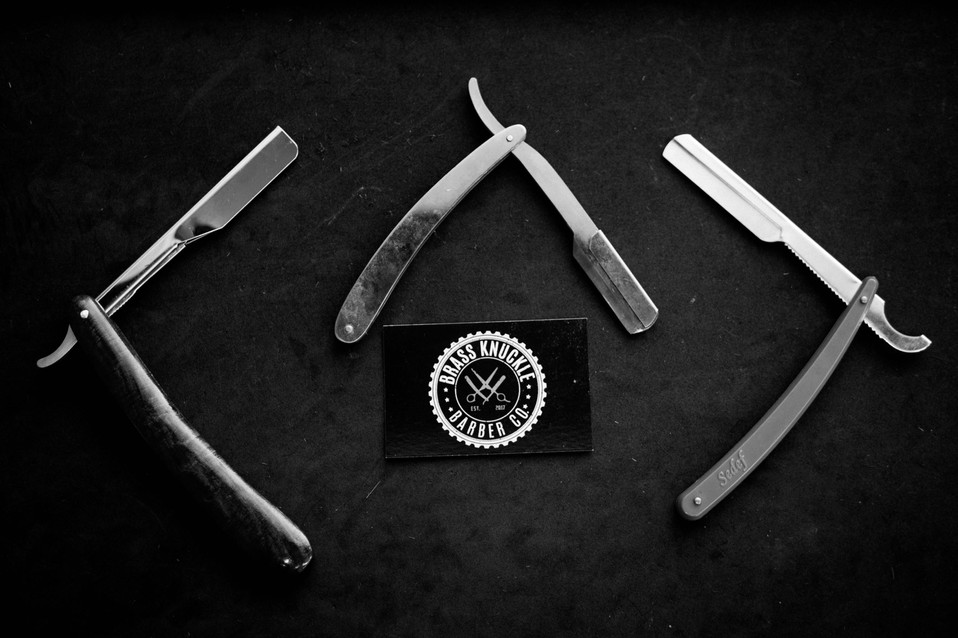 Brass Knuckle Barber Co cut throat razor and business card