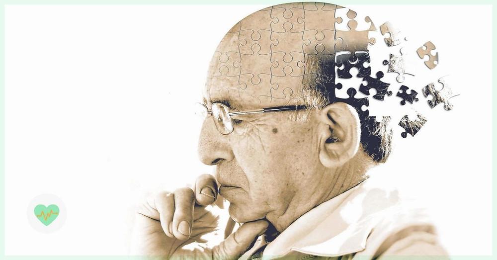 Representação do Alzheimer em um homem idoso com peças de quebra cabeça ilustrando como as memorias se perdem.
