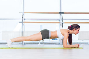training fitness woman doing plank core