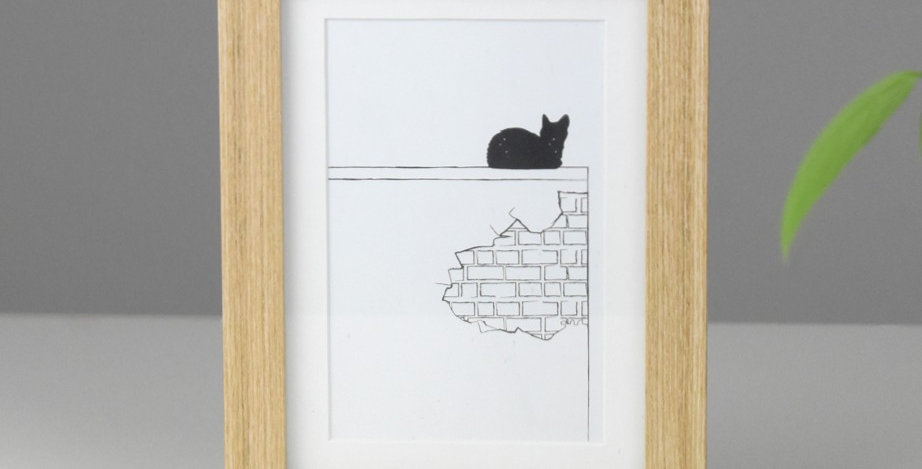 Cat in the city *FRAMED* wall