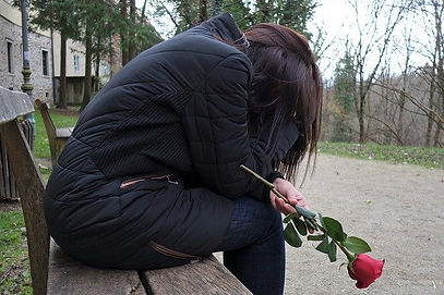 sad-girl-on-bench-with-one-red-rose.jpg