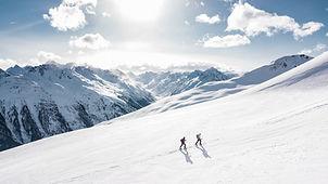 two-man-hiking-on-snow-mountain-869258.j