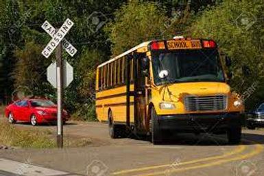 School Bus at Rail Crossing.jfif