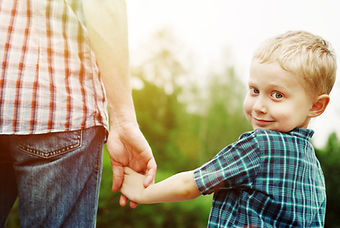 Boy holding dad's hand