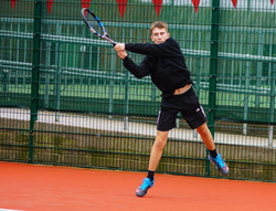 Ross takes a high backhand