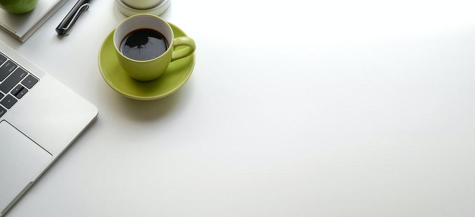 green-ceramic-mug-filled-with-black-coff