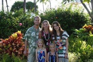 Bilateral Amputee, Lisa is posing with her family in Hawaiian Decor.