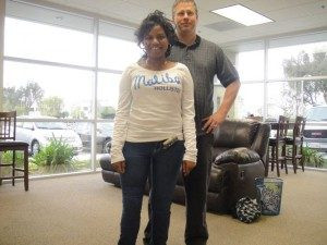 Cheerful Teen Alexus, who is an Above Knee Amputee, is pictured here standing and smiling on her prosthetic leg.