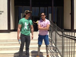 JR, a Bilateral Amputee, can be seen standing with someone wearing green outside of the old Southern California Prosthetics location.