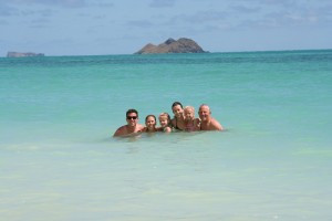 Bilateral Amputee Lisa is pictured with her family in the freezing crystal clear ocean water.
