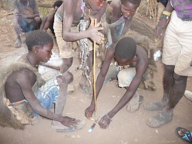 Local Tanzanian tribesman making fire