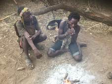 Tanzanian tribal boy smoking pipe