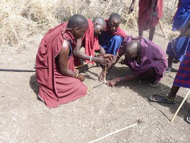 Tanzanian tribesmen making fire