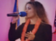 Athena singing with microphone.jpg