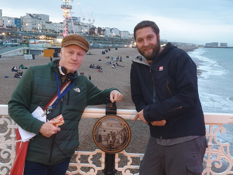 Chris Green and Max Williams visiting Being Plaque on Brighton Palace Pier