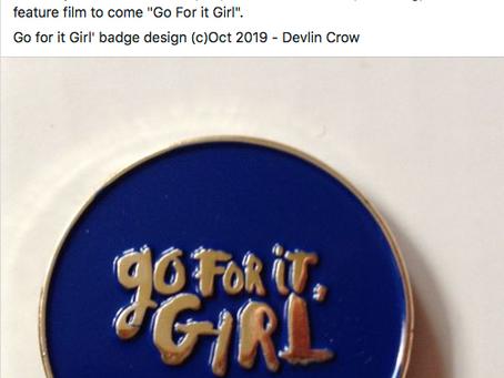 Josh Farley (aka Buddy in Being) wears 'Go For It Girl' badge.