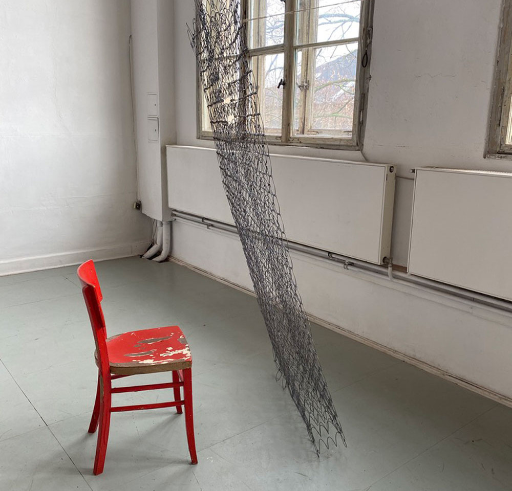 Mattress and Red Chair