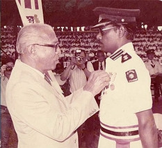 Mr V. Krishnan receiving the Serving Brother Medal