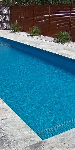 Silver travertine around pool Plenty.jpg