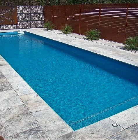 Silver travertine around pool Plenty.jpg