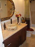 Onyx Sink, Travertine Tile Countertop, Tile Floor