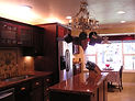 Custom Cabinets, Granite Countertop, Tile, Lighting, Pot Rack