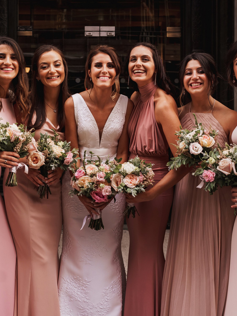 Beautiful bride and her bridesmaids